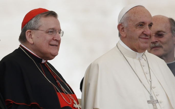 Archconservative cardinal Raymond Burke (left) was one of the authors of the 'dubia' sent to Pope Francis, to clarify the teaching in Amoris