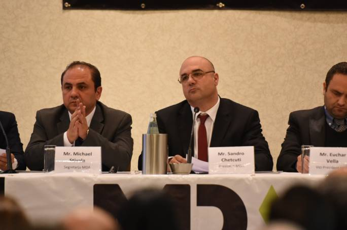 Sandro Chetcuti (centre) is insisting that contractors' profits have fallen over the past few years