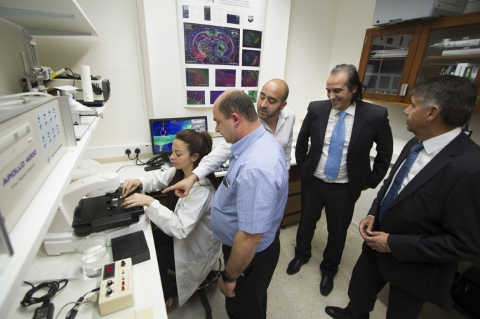 PhD student Jasmine Vella working on the new EVOS®FL Auto Imaging System with Prof Mario Valentino, researcher Dr Christian Zammit, Aaron Grima and Edwin Busuttil, Sales Executive and Managing Director respectively at E.J. Busuttil Ltd