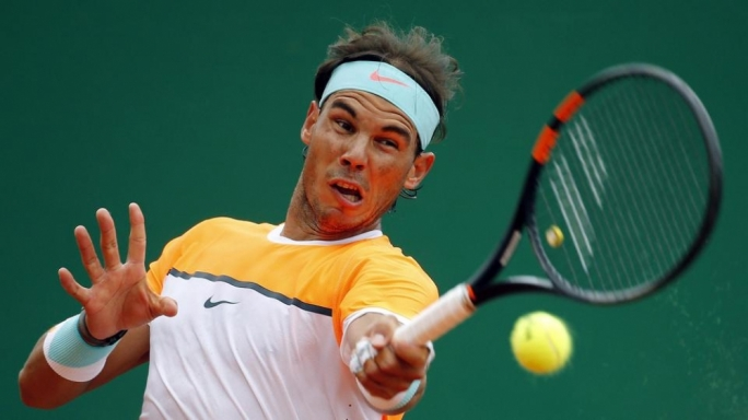 Rafael Nadal of Spain returns the ball to Lucas Pouille of France during their match at the Monte Carlo Masters in Monaco