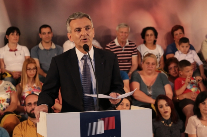 PN leader Simon Busuttil reads out from a magisterial decree at a political activity in Paola
