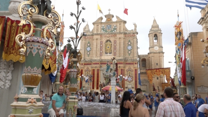 Groups of people in blue T-Shirts fill the Ghaxaq square to celebrate the much-anticipated feast of Santa Marija