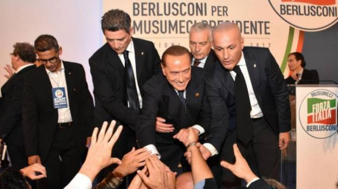 Eyeing national vote, Berlusconi celebrates win for center right in Sicily