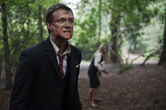 Haunted woods: Ed Speelers and Holly Weston are forced to keep their passengers safe from a werewolf invasion in this British horror indie