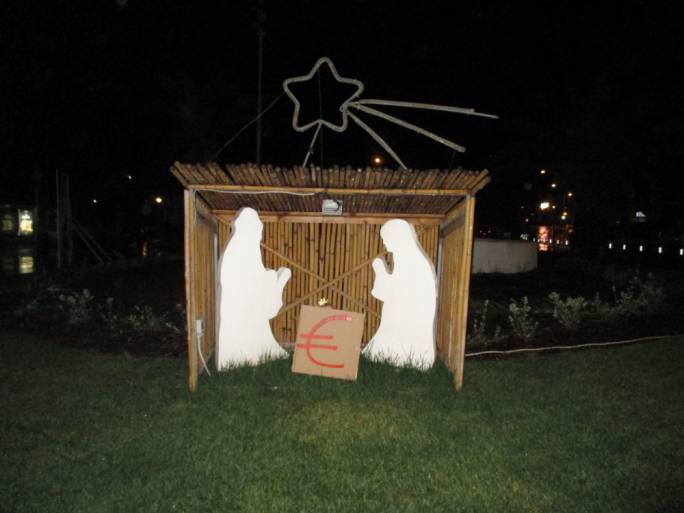An anonymous group replaced the Baby Jesus with a Euro sign on nativity cribs around the island as a from of protest against consumerism