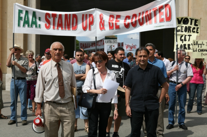 Flashback to 2006, when the extension of development zones by George Pullicino brought out a mass environmental protest that has, since then, been a constant fixture in Maltese civic life. To the right of the photo, note the best placard of all: 'Vote George, Get Lorry', equating Pullicino to the notorious Labour minister for works, himself a lover of concrete, Lorry Sant