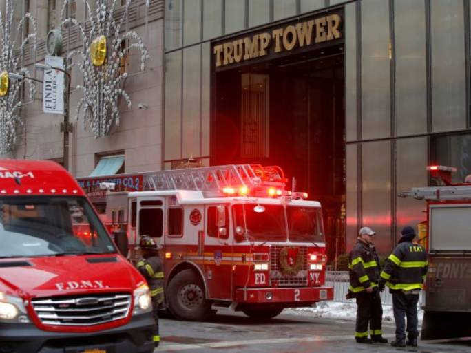 Firefighters fighting fire at Trump Tower; 2 injured