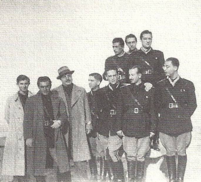 In full fascist glory: Borg Pisani dons his unfirom with colleagues (Borgt Pisani can be seen on the right of the group below looking to the left)