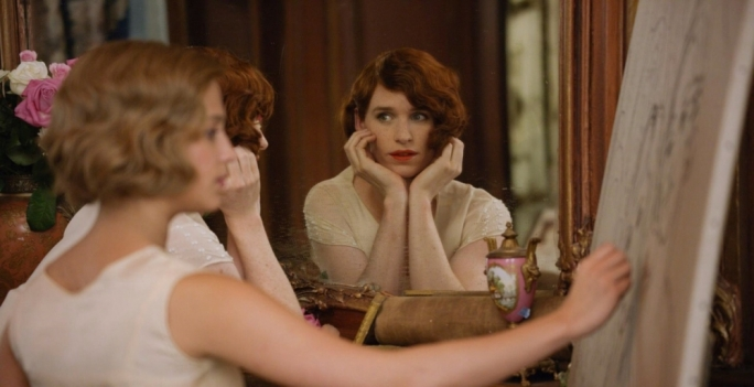 Eddie Redmayne (centre) guns for the Oscar once again as he takes on the role of the pioneering transgender painter Einar Wegener, helped along by his long-suffering wife Gerda (Alicia Vikander, left)