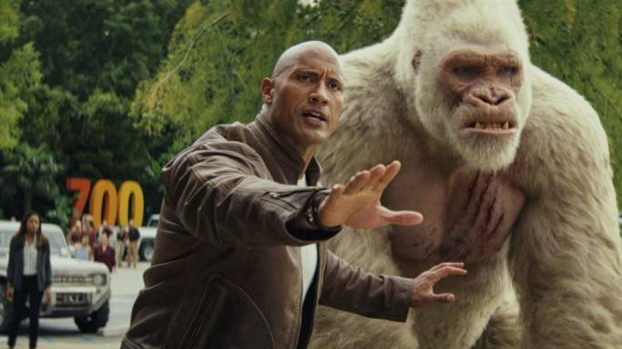 A (big) boy and his monkey: Dwayne 'The Rock' Johnson is the primatologist-with-pecs guardian to the albino gorilla George in Brad Peyton's ludicrously entertaining monster movie