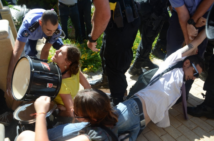 Protestors at the Planning Authority are removed forcibly by police officers and members of the RIU