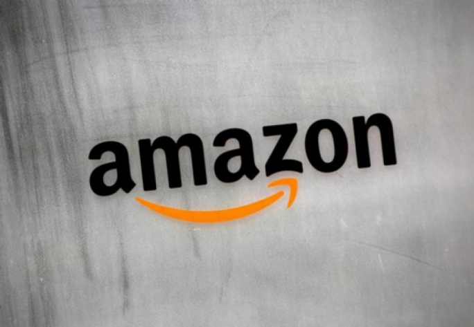 Shares of Amazon took centre stage after hitting an intraday record, exceeding $1,000 a share for the first time ever