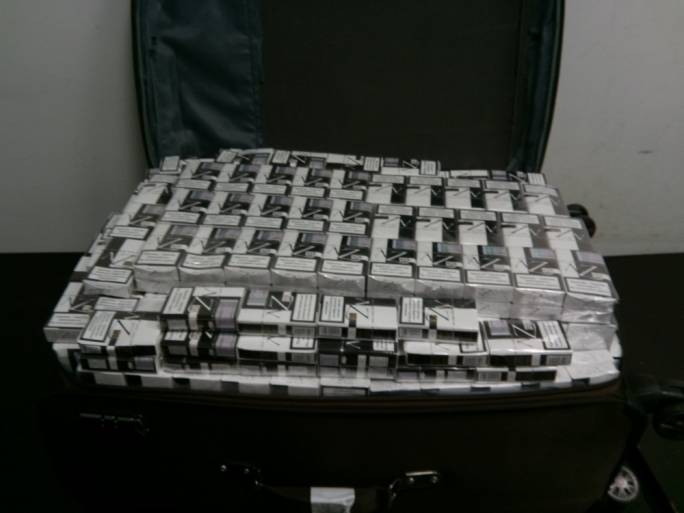 The contraband cigarettes were found inside the passenger's hand luggage