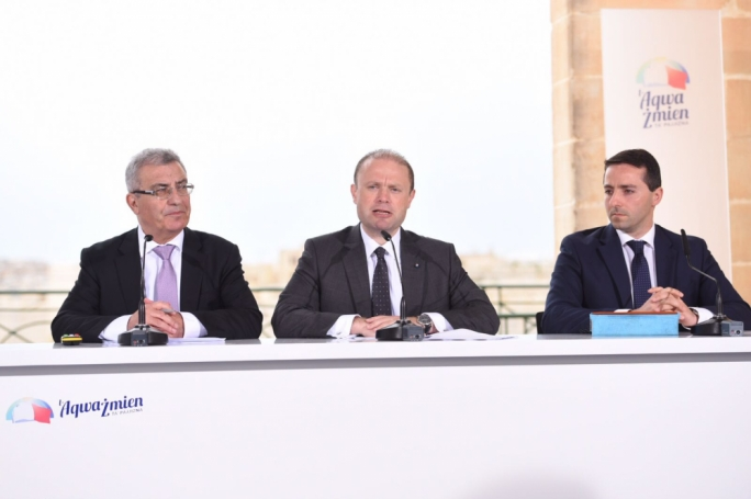Prime Minister and Labour Party leader Joseph Muscat addresses a press conference with education minister Evarist Bartolo (L) and Alex Muscat. Photo: James Bianchi/MediaToday