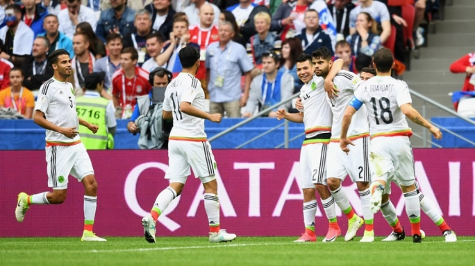 The Mexican players celebrating their equalising goal against Russia