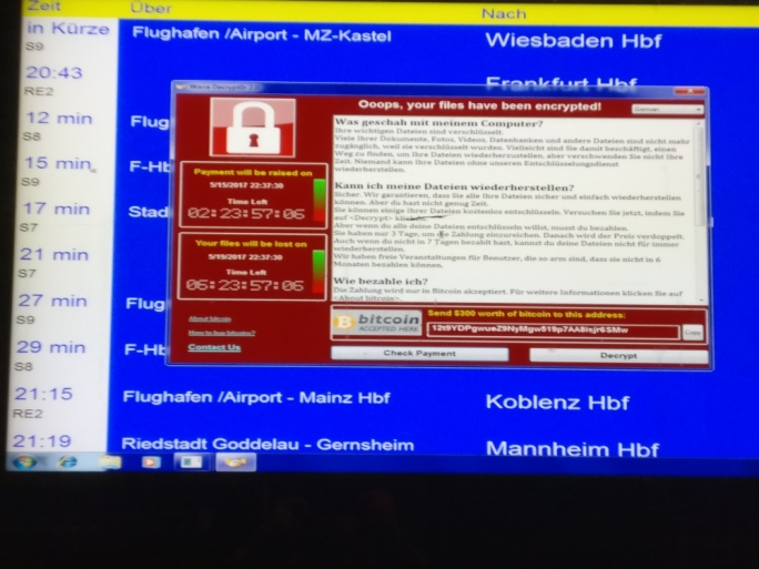 A message from the ransomware as seen on German airport electronic noticeboard (source: Twitter)