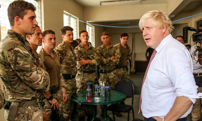 Foreign secretary Boris Johnson with Royal Marines of 40 Commando in Tortola in the British Virgin Islands after Hurricane Irma, who have helped round up the escaped prisoners. (Photo: The Guardian)