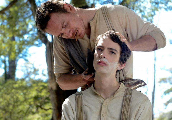 Close shave: Michael Fassbender (top) and Kodi Smit-McPhee make for unlikely companions in John Maclean's directorial debut
