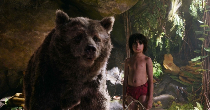 Bear Necessities: Mowgli (Neel Sethi) hangs out with Baloo (Bill Murray) in Jon Favreu's remake of the 1967 Disney animated classic