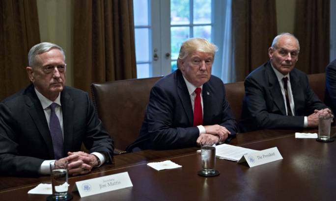 President Donald Trump sits with John Kelly, White House chief of staff, right, and Jim Mattis, US secretary of defense, during a briefing with senior military leaders in the Cabinet Room of the White House in Washington (Photograph: the Guardian)