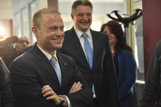 Joseph Muscat (left) said he will reward competence, seniority and vote-winners with Cabinet positions.