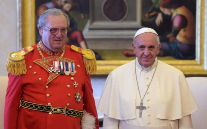 Matthew Festing (left) and Pope Francis, who forced the former Grand Master's resignation