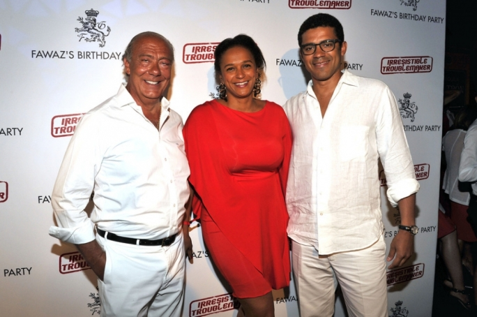 Africa's top billionaire Isabel dos Santos (centre) uses Malta shell companies to hold major interests in state-owned diamonds, banking, and telecoms. She is pictured here with De Grisogono founder Fawaz Gruosi (left) and husband Sindika Dokolu
