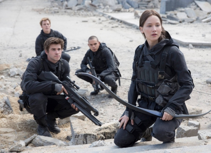 Bows at the ready: Katniss (Jennifer Lawrence) and Gale (Liam Hemsworth) lead the attack in this final installment of the hugely popular young adult book-and-film saga