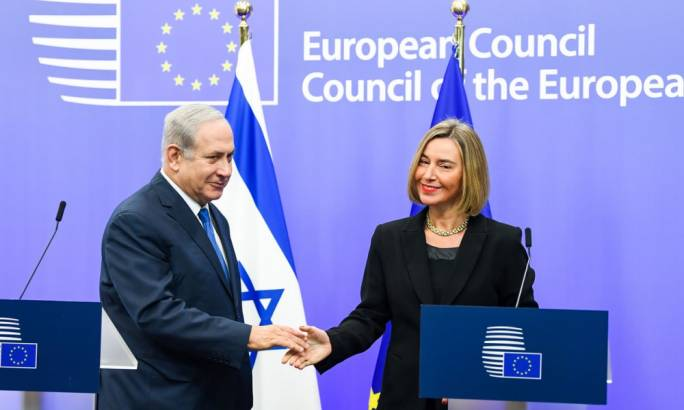 Benjamin Netanyahu and Federica Mogherini meet in Brussels. She told him the EU would continue to recognise the 'international consensus' on Jerusalem (Photo: Rex)