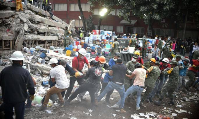 Rescuers and volunteers search for survivors in a flattened building in Mexico City. The mayor said across the city 52 people had been pulled out alive (Photo: Yuri Cortez/AFP)