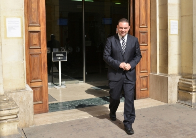 Justice minister Owen Bonnici exits the courts after being acquitted of negligent driving in October 2014