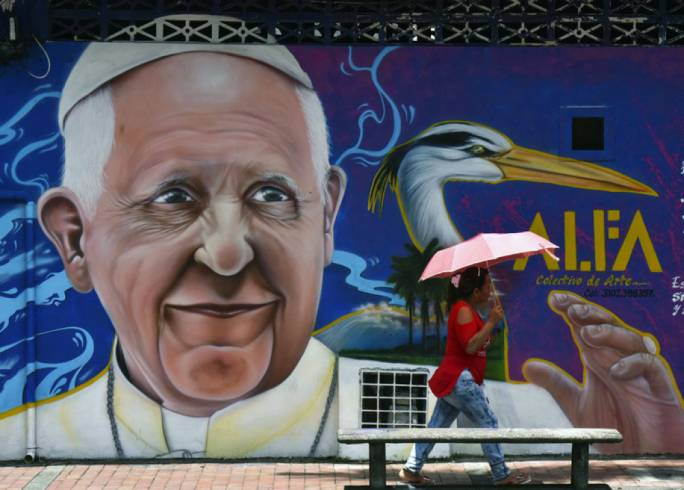 A painting of Pope Francis in Villavicencio, Colombia. Francis arrives in the country on Wednesday. Photo: the NY Times