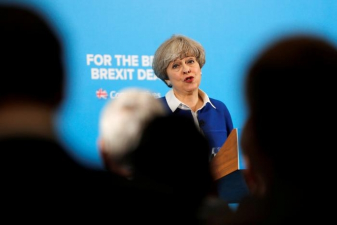 May, Corbyn set out opposing Brexit stances