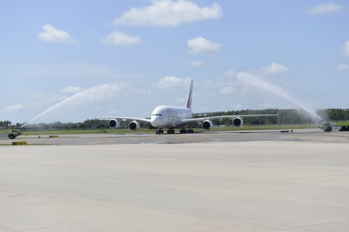 An Emirates A380 aircraft receives a traditional water cannon salute upon its arrival at Orlando International Airport