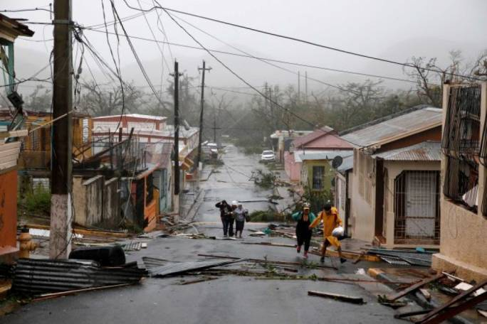 Rescue workers aiding people after Hurricane Maria struck (Photo: ABC News)