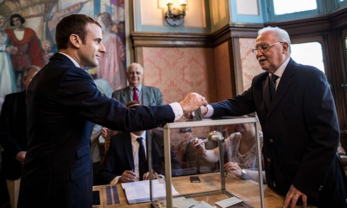 Emmanuel Macron casts his ballot in Le Touquet, northern France