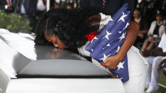 Myeshia Johnson at her husband's coffin at his funeral in Hollywood, Florida (Photo: BBC News)