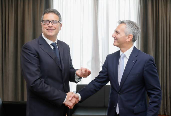Adrian Delia (left) being handed the keys to the office by outgoing leader Simon Busuttil (right)