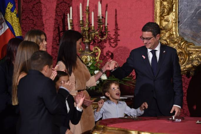 Adrian Delia's youngest son joins in the family congratatulations after his father is sworn in as Opposition leader. (Photo by James Bianchi/MediaToday)