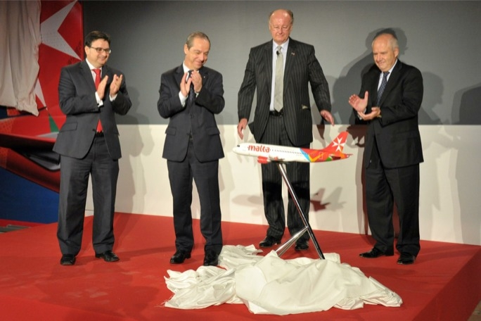 Lawrence Gonzi and Tonio Fenech are shown the new livery design of the Air Malta aircraft CEO Peter Davies and chairman Louis Farrugia.