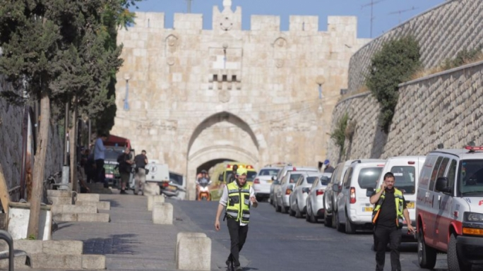 Emergency personnel at the site of the shooting attack in Jerusalem's Old City