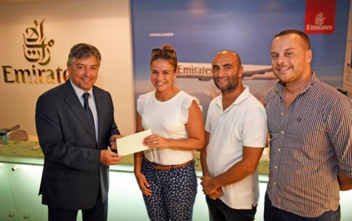 Emirates Malta manager Paul Fleri Soler presenting the gift vouchers to Alexandra Vella in the presence of Daniel Chircop and Sander Aguis
