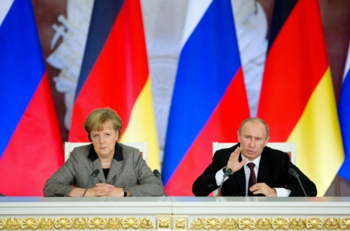 Merkel (left) accused Moscow of trying to make countries in the western Balkans economically and politically dependent on Russia in order to gain influence there.