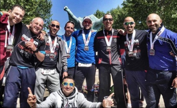 Triathletes Steven Banavage, Kevin Zammit, Jean Marc Camilleri, Matthew Mirabelli, Josef Zarb, Niki Bilocca, Donald Vella, Daniel Agius and (crouching) Stefan Borg celebrating after the race.Photo by David Agius Lia