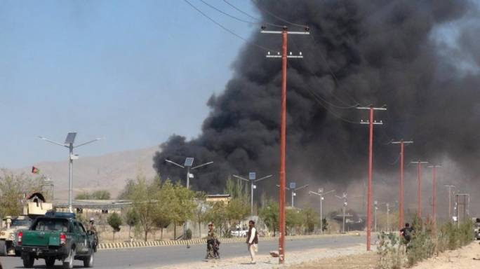 Smoke rises from police headquarters while Afghan security forces keep watch after a suicide car bomber and gunmen attacked the provincial police headquarters in Gardez, the capital of Paktia province, Afghanistan on 17 October (Photo: Reuters)