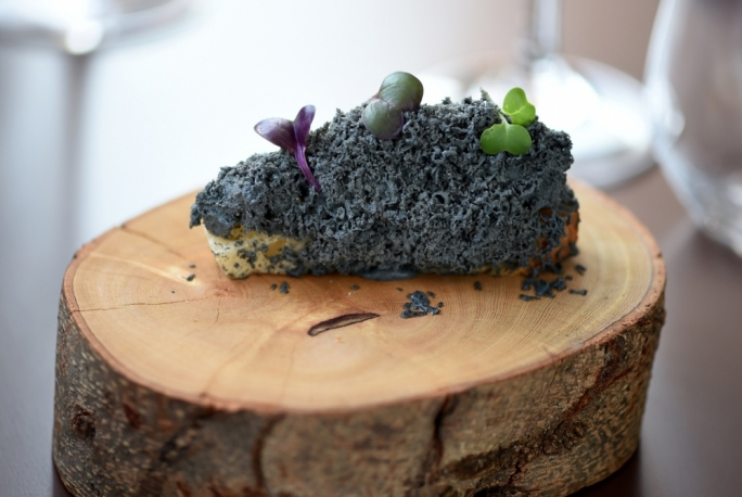 Foie gras ashes served on crystal bread