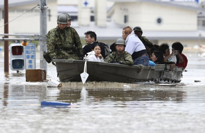 Flooding has killed more than 60 people in West Japan