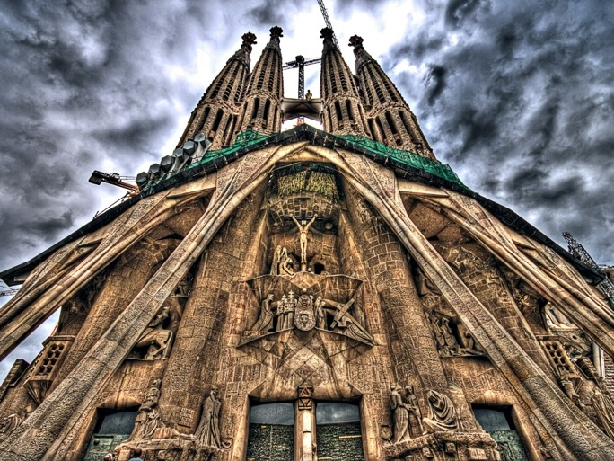 At first glance, it seems as though a careless giant has dripped melting wax over a the Sagrada Familia Gothic cathedral