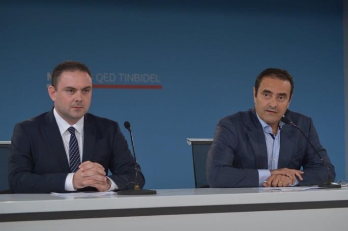 Justice minister Owen Bonnici and Labour CEO Gino Cauchi address a press conference