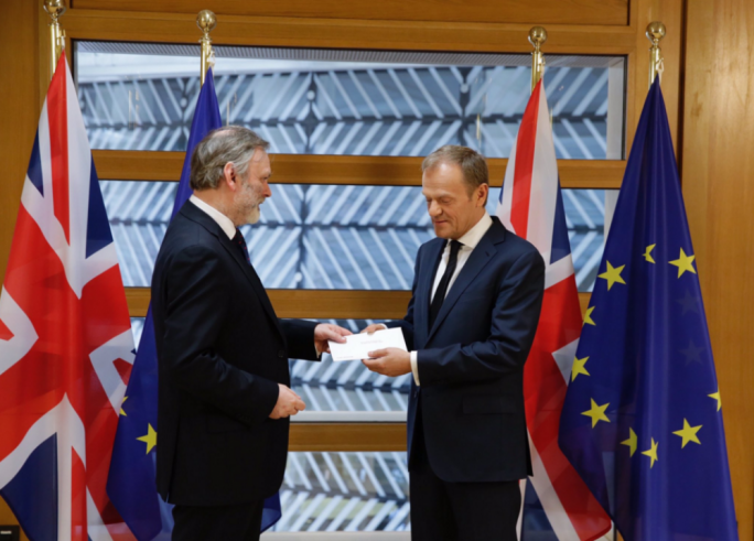 Tim Barrow delivering the letter of notice to EU Council President Donald Tusk